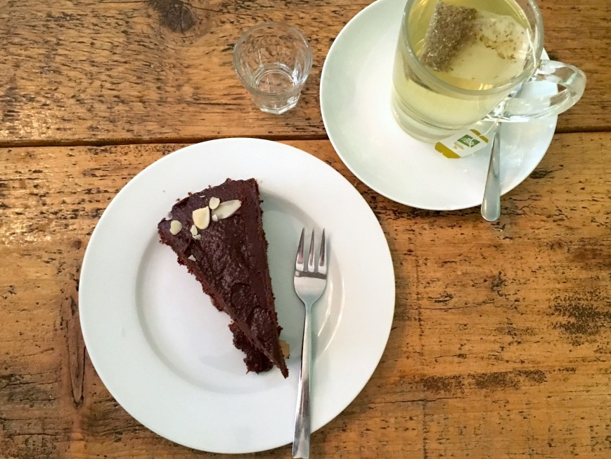 Vegan chocolate cake with pear and camomile tea